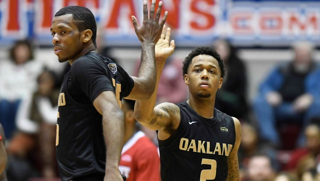 Oakland star guard Martez Walker, left, is out for the season with a broken left ankle.