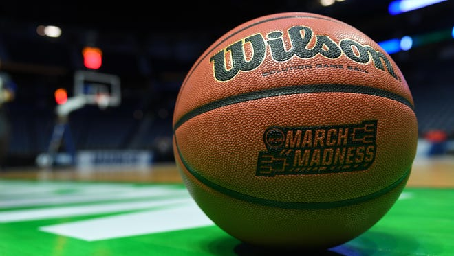 Mar 15, 2018; Nashville, TN, USA; General view of a basketball and the March Madness logo prior to practice the day before the first round of the 2018 NCAA Tournament at Bridgestone Arena. Mandatory Credit: Christopher Hanewinckel-USA TODAY Sports