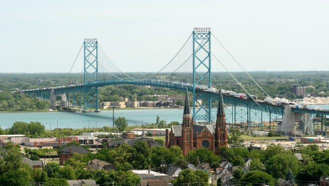 The Moroun-owned Ambassador Bridge is seen from the Michigan Central Depot.