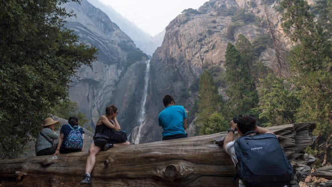Lower Yosemite Falls is just one of the landmark vistas obscured by smoke from the Ferguson Fire in Yosemite National Park on Tuesday, July 24, 2018.