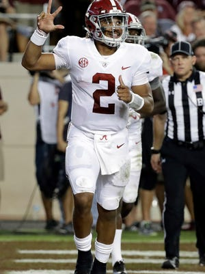 Alabama quarterback Jalen Hurts (2) celebrates after rushing for a touchdown against Texas A&M during the second quarter of an NCAA college football game Saturday, Oct. 7, 2017, in College Station, Texas. (AP Photo/David J. Phillip)