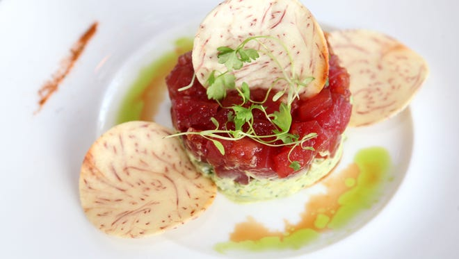 The Tuna Tartare, with Hass avocado and taro root chips, is photographed at Plates.