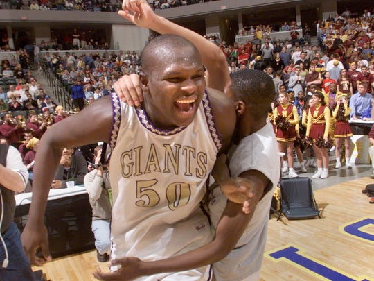 Marion's Zach Randolph celebrates as he is mobbed by teammates on the floor on Conseco Fieldhouse Sat. Mar. 25 after leading his team to the class 4A state title. Marion downed Bloomington North in the final.  Randolph is now with the Memphis Grizzlies.