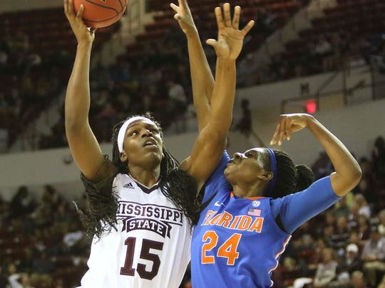 Mississippi State center Teaira McCowan shoots over Florida center Tyshara Fleming during the first half of Thursday's game.