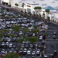 This Desert Sun file photo shows a full parking lot in Palm Desert during the holiday shopping season. Traffic officials encourage drivers to be cautious when navigating busy parking lots.