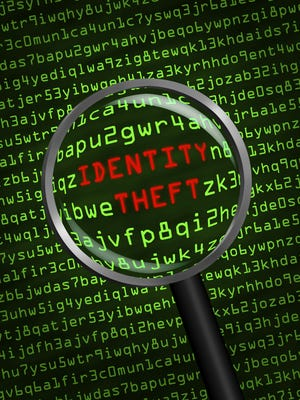 Identity Theft revealed in computer code through magnifying glass