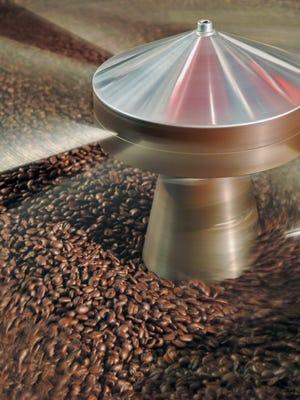Coffee beans cool after being dark roasted at Vermont Artisan Coffee & Tea in Waterbury.