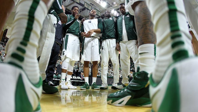 The Michigan State Spartans huddle up prior to a game against the Binghamton Bearcats  at Jack Breslin Student Events Center.