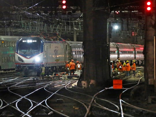 In this July 9, 2017 file photo, Amtrak workers continue