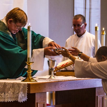 Rev. Lee Montgomery of the St. Jude's Episcopal Church leads the Sunday services, Nov. 22, 2015.