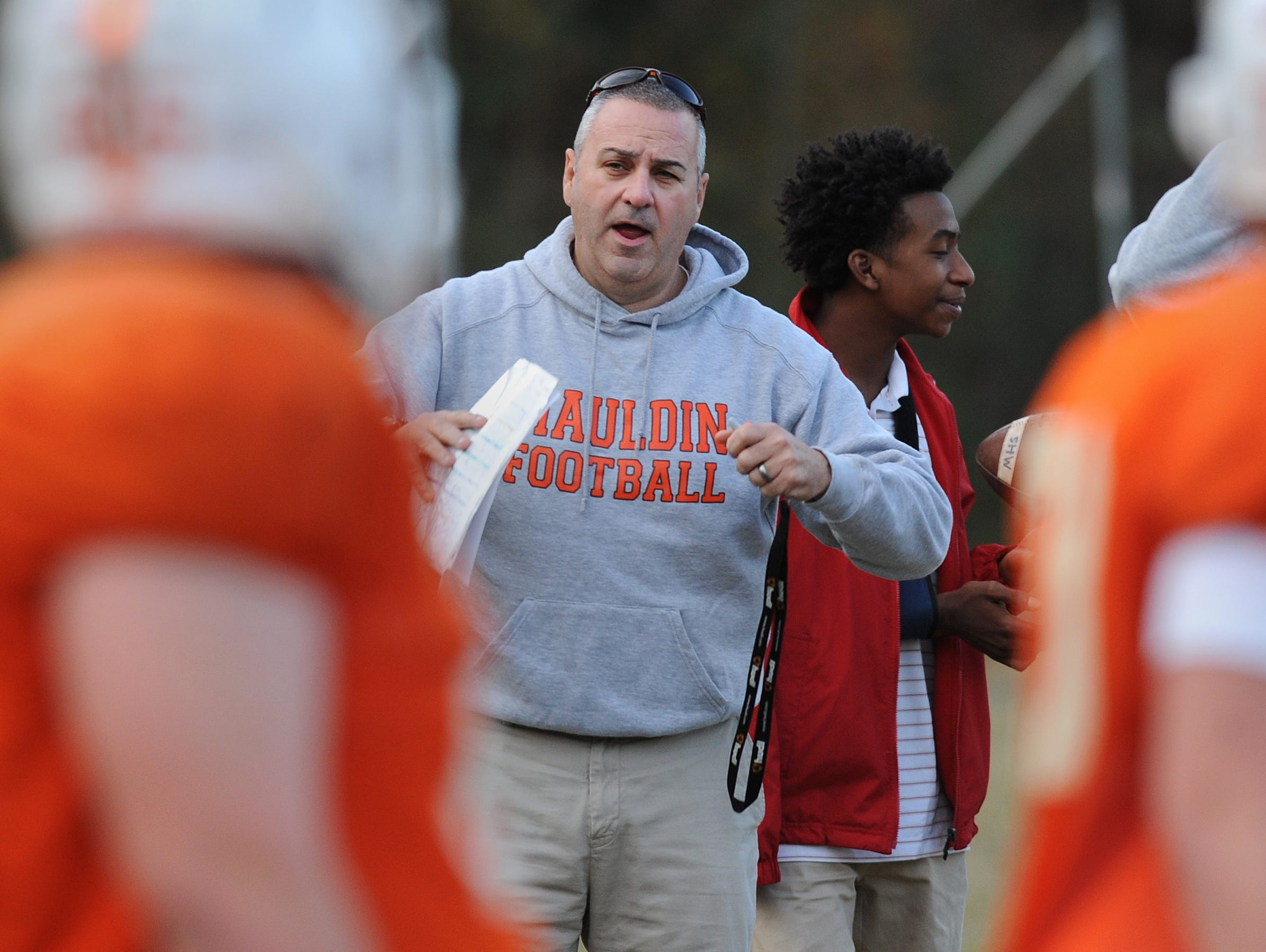 Mauldin head coach Lee Taylor calls plays to the offense during the teams practice Monday, November 16, 2015. Mauldin will play Hillcrest in the 1st round of the AAAA playoffs Friday at Hillcrest.