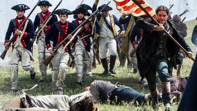"""Actors portray Revolutionary War soldiers in a scene from """"Sons of Liberty,"""" a new miniseries premiering in January 2015 on the History Channel."""
