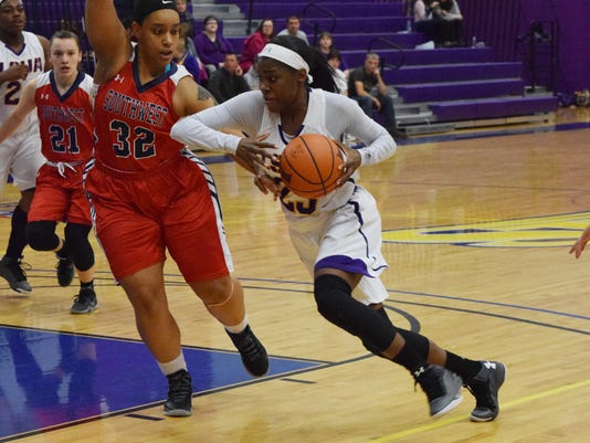 LSU at Alexandria's Pearl Paulo (23, left) drives to the basket against University of the Southwest's Cassandra Smith Saturday.