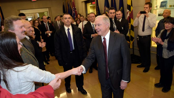 Attorney General Jeff Sessions is greeted by employees as he arrives at the Justice Department in Washington, Thursday, Feb. 9, 2017.