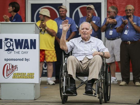 Former Gov. Bob Ray waves to an appreciative Iowa State Fair crowd on Friday, Aug. 8, 2014, after being named the Iowan of the Day. He was the first elected official to get the honor.