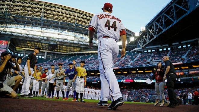 March 31, 2014 - Arizona Diamondbacks first baseman Paul Goldschmidt (44) takes the field for Opening Day ceremonies along with the San Francisco Giants at Chase Field.