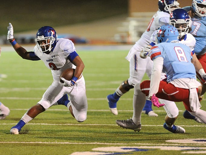 Cooper running back Tyrees Whitfield makes a cut while