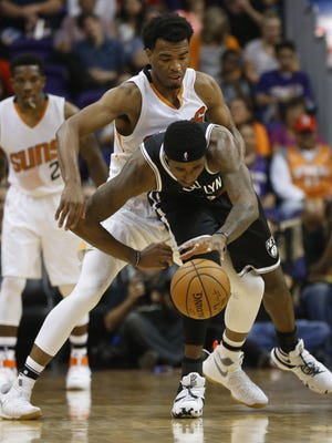 Suns' TJ Warren (12) knocks the ball away from Nets' Rondae Hollis-Jefferson (24) at Talking Stick Resort Arena on November 12, 2016 in Phoenix, Ariz.
