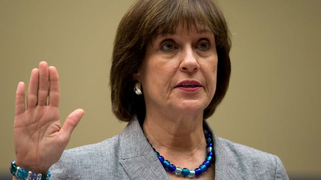 IRS official Lois Lerner is sworn in at a May 22, 2013, hearing of the House Oversight Committee. Lerner invoked her constitutional right to not answer lawmakers' questions.