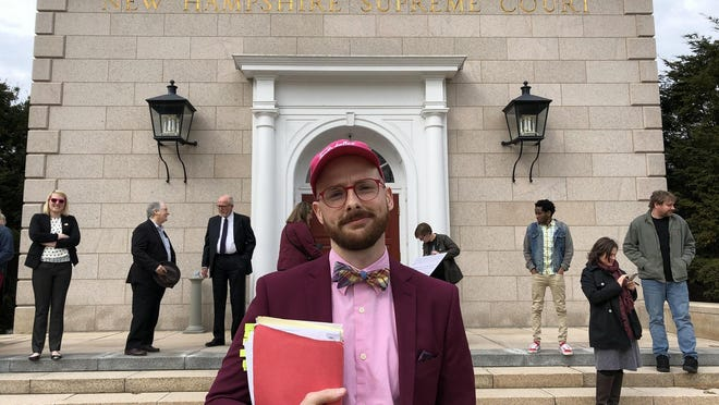 Teatotaller owner Emmett Soldati stands outside New Hampshire Supreme Court in March after providing oral arguments in a breach of contract suit against Facebook and Instagram. Supreme Court justices ruled Friday in favor of Soldati, a pro se litigant.