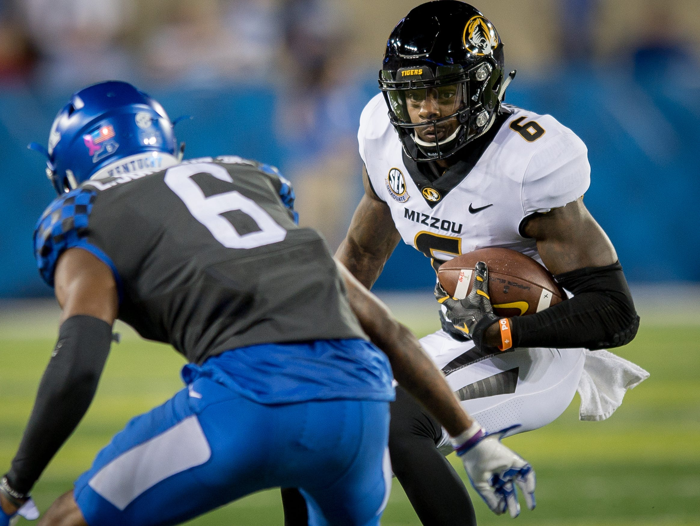 DUPLICATE***Kentucky Wildcats cornerback Lonnie Johnson (6) tackles Missouri Tigers wide receiver J'Mon Moore (6)uring the game at Kroger Field on the campus of the University of Kentucky in Lexington, Saturday, Oct. 7, 2017.