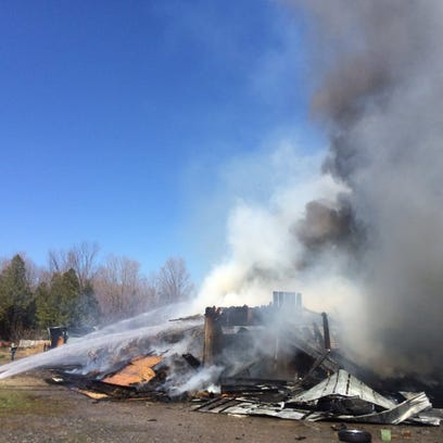 Fire crews work to extinguish a blaze that destroyed