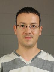Andrew Heinisch turned himself into police Thursday