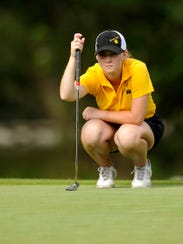 Blanket's Marki Kinkade lines up her putt on the third green during the first round of the 2017 Class 1A UIL state golf tournament at Lions Municipal Golf Course in Austin.