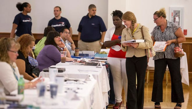 Job seekers and company representatives fill the Middletown Memorial Fire Hall for a job fair geared toward veterans in 2013.