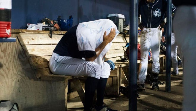 Asheville Tourists outfielder Omar Carrizales sits in the dugout in disbelief in the bottom of the ninth inning en route to a 5-1 defeat by Hickory to end the South Atlantic League Championship Series Thursday night at McCormick Field.