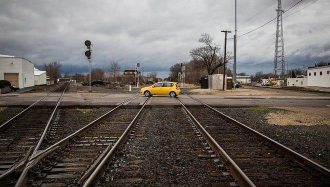 Traffic crosses the railroad crossing on Walnut Street in December 2015.