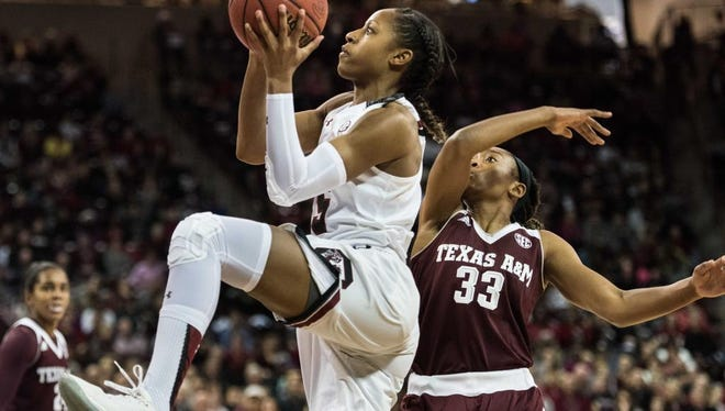South Carolina guard Tiffany Mitchell, front left, drives to the hoop against Texas A&M guard Courtney Walker (33) during the first half of an NCAA college basketball game Sunday, Jan. 17, 2016, in Columbia, S.C.  (AP Photo/Sean Rayford)