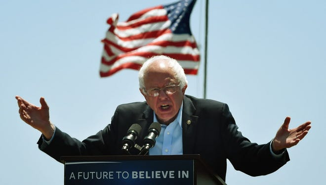 Democratic presidential hopeful Bernie Sanders speaks to supporters at an election rally in Ventura, California on May 26, 2016.