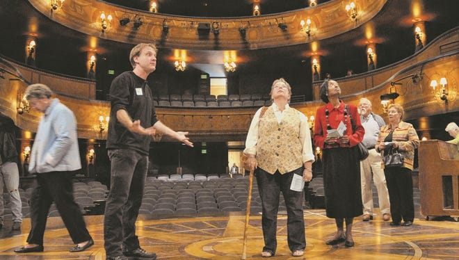 Former Skylight stage supervisor Andrew Booher talks to guests during a Broadway Theatre Center open house in 2009. Skylight has sold the center, its performing home, to a local developer in a leaseback deal that gets Skylight out of the building management business.