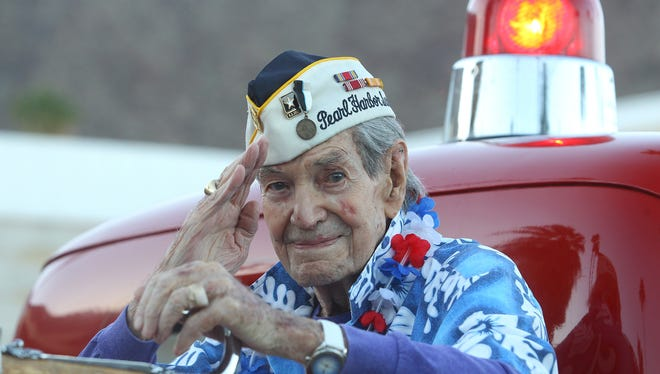 A veteran and survivor of Pearl Harbor, salutes the community during the Palm Springs Veterans' Parade in downtown Palm Springs on November 11, 2016.