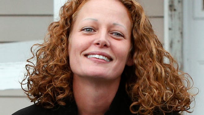 In this Oct. 31, 2014 file photo, Kaci Hickox comes out of her house to speak to reporters in Fort Kent, Maine.
