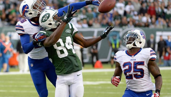Buffalo Bills defensive back Justin Rogers (26) tips away a pass for New York Jets wide receiver Stephen Hill (84) during the first half at MetLife Stadium.