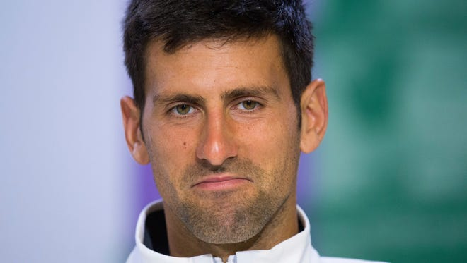 Novak Djokovic pauses during a press conference at Wimbledon in July.