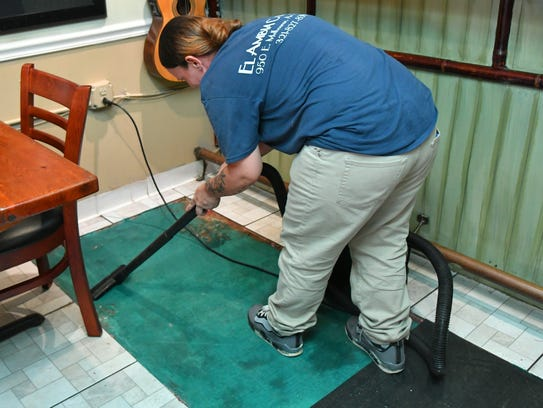 El Ambia Cubano workers had to remove floor tiles and