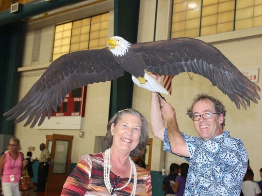 GYAC Director of Philanthropy Peggy Gibbs with Golden Rod puppeteer Hobey Ford and the bald eagle he created for the show