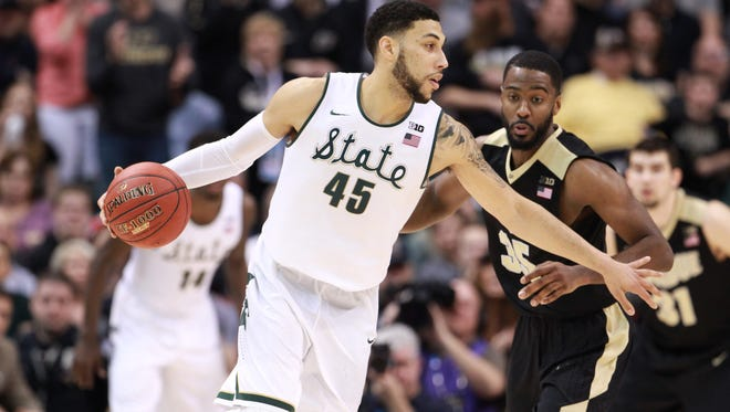 Mar 13, 2016: Michigan State Spartans guard Denzel Valentine (45) is guarded by Purdue Boilermakers guard Raphael Davis (35) during the Big Ten conference tournament at Bankers Life Fieldhouse. Michigan State defeats Purdue 66-62.