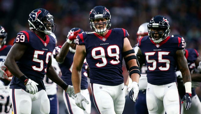 Houston Texans defensive end J.J. Watt (99) reacts after a play during the first quarter against the New England Patriots at NRG Stadium.