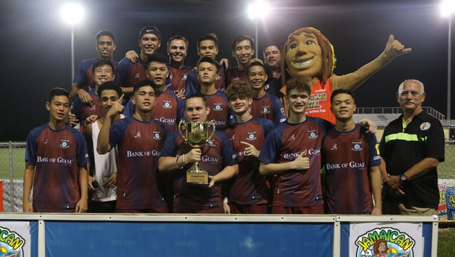 The Bank of Guam Strykers I pose with the championship trophy of the Jamaican Grill 11th Annual GFA Cup, Guam's premier men's soccer tournament, following the final match against the NAPA Rovers FC Saturday evening at the Guam Football Association National Training Center. The Strykers I won 5-1 to claim the 2018 title.