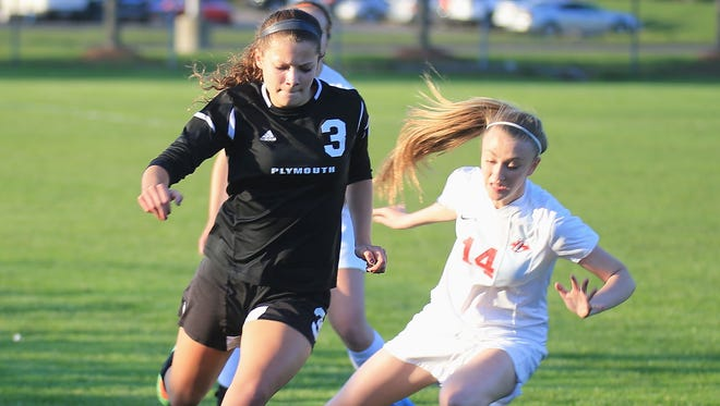 Plymouth's Olivia Janke (No. 3), who scored both of the Wildcats' goals Tuesday, battles for the ball against Canton's Mary Galm.