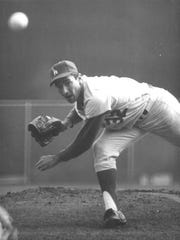 Sandy Koufax of the Los Angeles Dodgers shuts out the Minnesota Twins, 2-0, in Game 7 of the 1965 World Series.