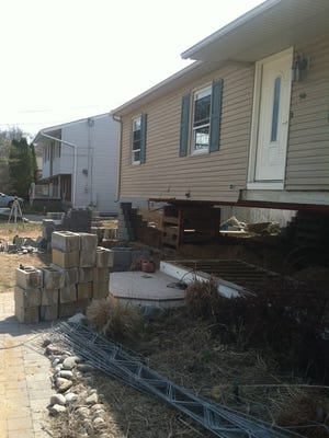 William and Cheryl Braden's home in Toms River during the elevation process.