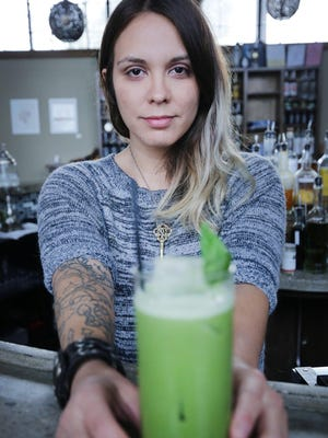 Ashley Rehm , a mixologist at Two James Spirits, at 2445 Michigan Ave.