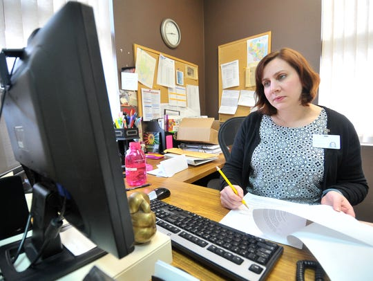 Executive director Laura Scudiere, of Wausau, does