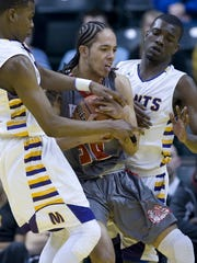 DENNY SIMMONS / COURIER & PRESS Bosse's Ethan Thomas (30) comes up with a loose ball between two Marion defenders during the 3A state championship game at Bankers Life Fieldhouse in Indianapolis Saturday night.