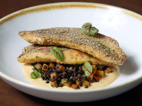 Striped bass with fall squash, braised lentils and